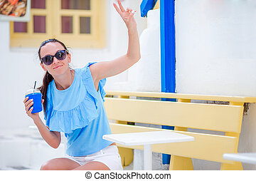 Young woman with coffee outdoor in the city