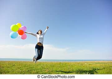 young woman with colored balloons - young asian woman ...