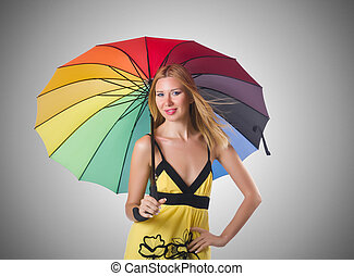 Young woman with colourful umbrella