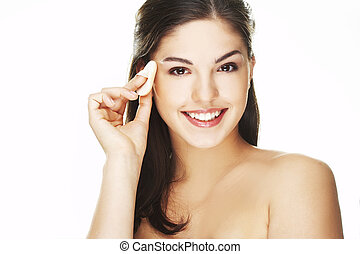 young woman with cosmetic petal