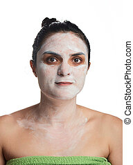 young woman with cream on face