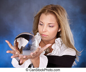 Young woman with crystal ball. - Young beautiful woman with...