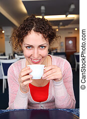 Young woman with cup in cafe