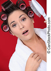 young woman with curlers on her hair