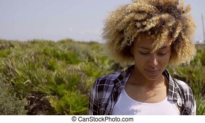Young Woman with Curly Hair Looking Down - Head and...