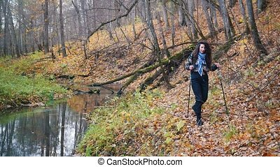 Young woman with curly hair on scandinavian walk in the...