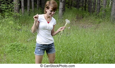 Young woman with dandelions