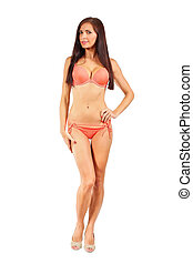 Young woman with dark long hair in red bikini swim wear isolated on white background.