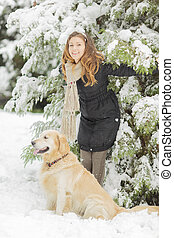 Young woman with dog at winter