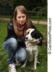 Young woman with dog in the park
