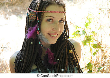 Young woman with dreadlocks, outdoor in autumn park