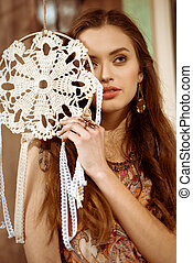 Young woman with dreamcatcher