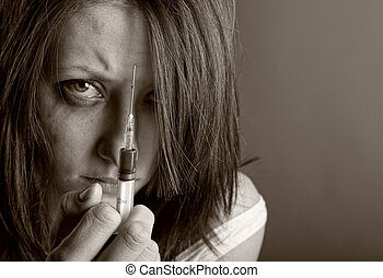 Young woman with drug addiction. Black and white photo