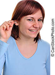 young woman with ear cleaner to clean ear