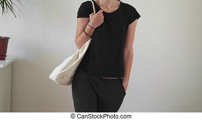YOung woman with eco friendly canvas bag. Sustainable living . Zero waste