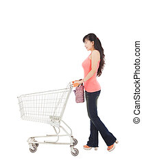 young woman with empty shopping cart