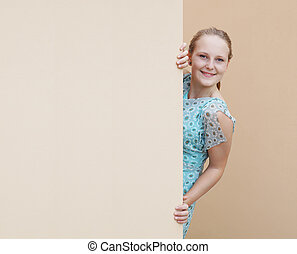 young woman with empty wall