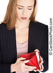 Young woman with empty wallet