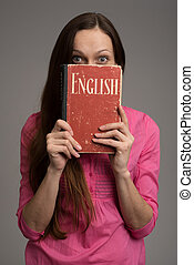 Young woman with English textbook