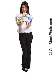 Young woman with euro money in her hands, isolated on white background