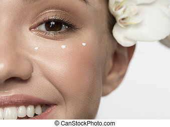 Young woman with facial mask at beauty salon - Skin care...