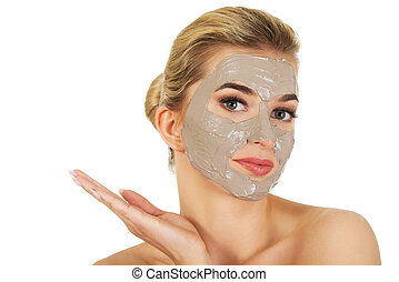 Young  woman with facial mask