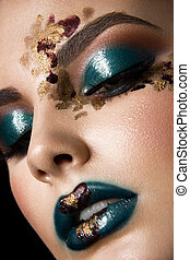 Young woman with fantasy bright make up.