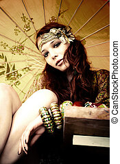 young woman with fashion accessories and parasol portrait