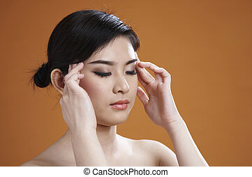 young Woman with fingers on temples