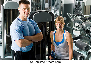 Young woman with fitness trainer