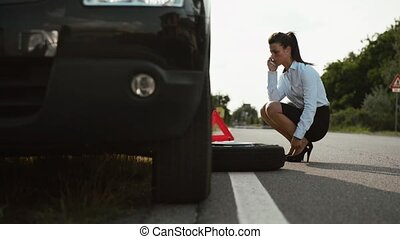Women, emergency and driving problems, frustrated girl with flat car tyre calling tow truck