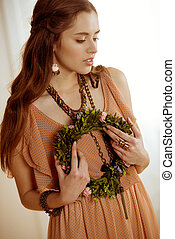 Young woman with floral wreath