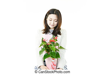 Young woman with flower pot