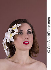 Young woman with flowers in her hair. Studio shot