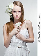 Young woman with flowers