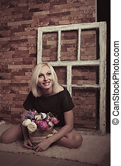 Young woman with flowers. Studio shot