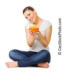 Young woman with fruit salad