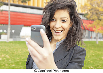 Young Woman with funny hair smile using cell phone walking