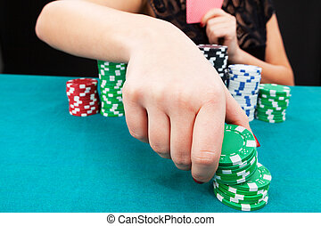Young woman with gambling chips