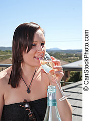 young woman with glass of wine