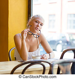 Young woman with glasses at cafe