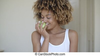 Young Woman With Green Apple In Hands