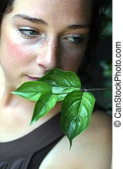 young woman with green foliage