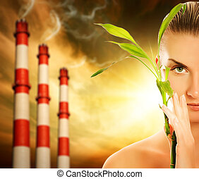 Young woman with green plant. Global warming concept