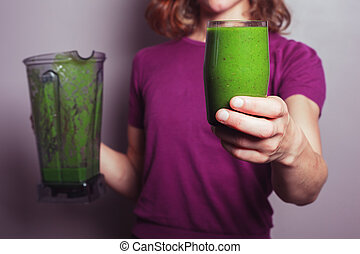 Young woman with green smoothie