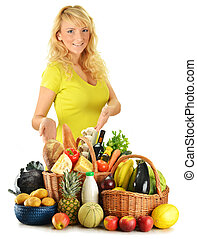 Young woman with groceries isolated on white