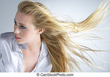 Young Woman With Hair Blowing Behind