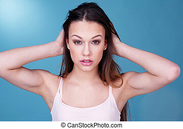 Young Woman with Hair in Hands