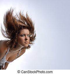 young woman with hair in motion