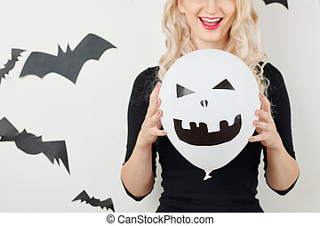 Young woman with Halloween decoration